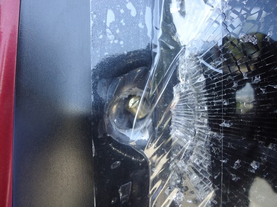 fired bullet on a car's window
