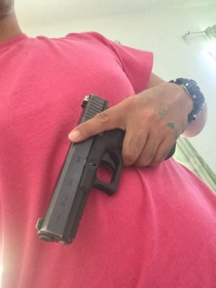 glock 17 being held by a man near chest
