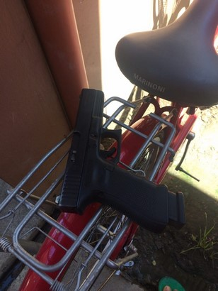 glock 17 g4 and a magazine on a bicycle side view