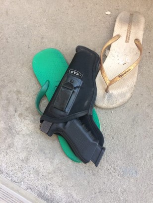 glock 17 g4 and magazine on the floor with slippers side view