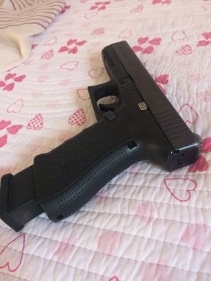 glock 17 g4 and magazine on top of bedsheet