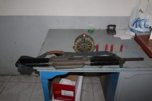 m4 riffle and ammos on a table