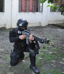 swat personnel with m16 riffle on kneeling position