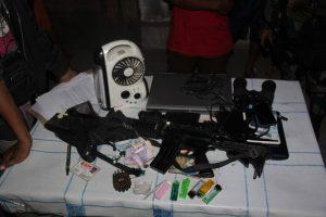 m4 sub machine gun on a table