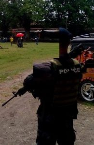 police officer holding an m16 riffle back view