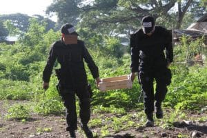 two police officers carrying explosives